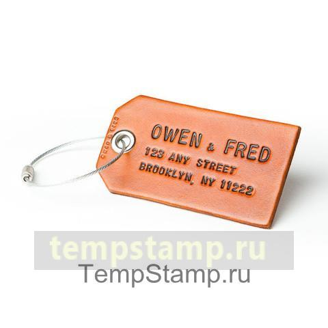 """Stamp for embossing on a keychain and a scabbard"""